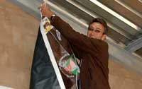 Nico putting up banner of Bonsmara Catte Breeders
